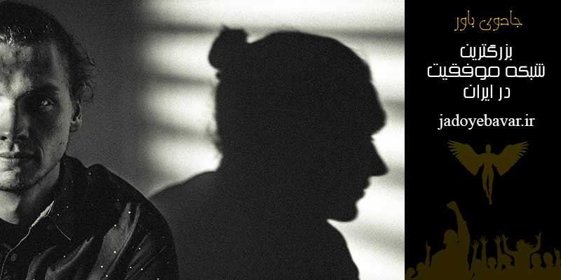 A boy in the dark shadow on the wall