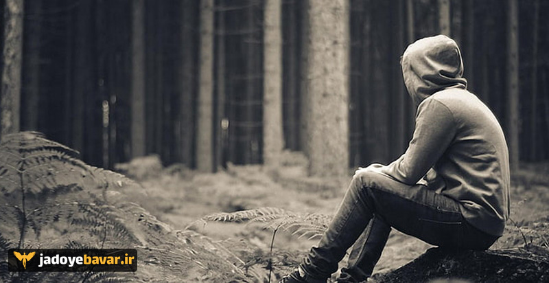 A depressed man in the forest