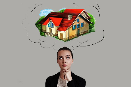 A woman is Visualize a house