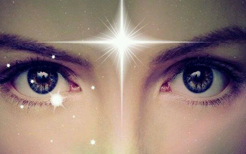 The third eye of a woman who is luminous